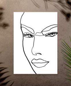 Plakat z konturami kobiecej twarzy do sypialni