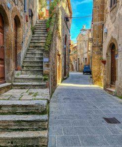 Plakat z architekturą włoskiego miasteczka