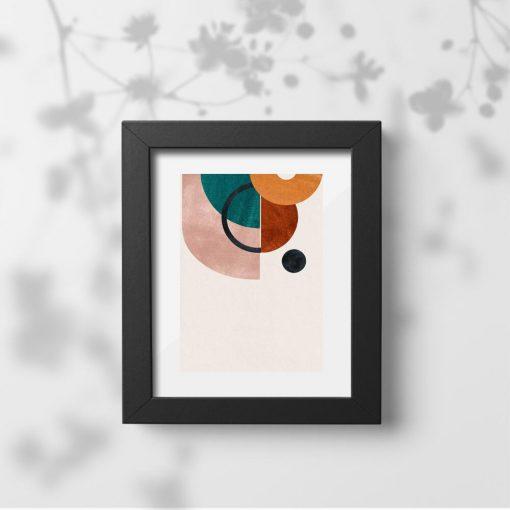 Plakat z kolorowymi okręgami i czarna kropką